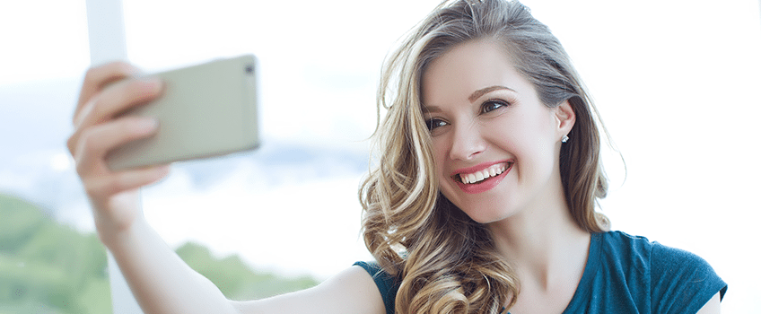 Young woman on phone broadcasting on periscope