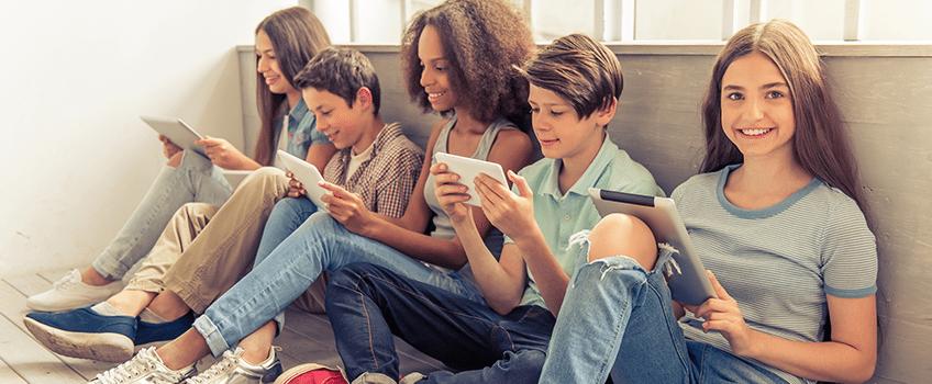Kids on tablets using app