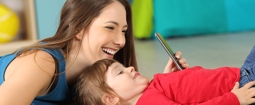 5 Simple Ways to Avoid Fake Mom Influencers - Mother and Child on Phone