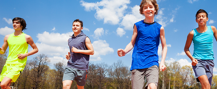 young men running outside in athletic wear