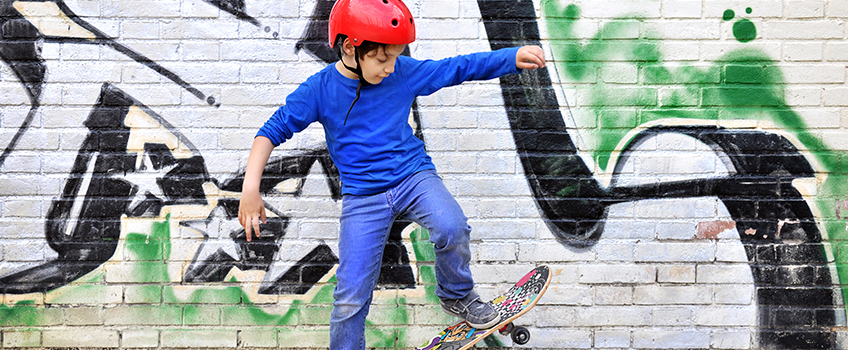 Young boy skateboarding in jeans