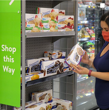 Woman in store looking at food