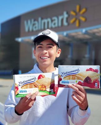 Boy showing snacks outside of Walmart